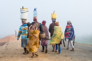 Mozambican ladies collecting water by wildlife and conservation photographer Peter Chadwick